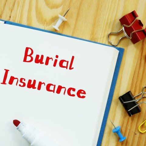 burial insurance written on a notepad