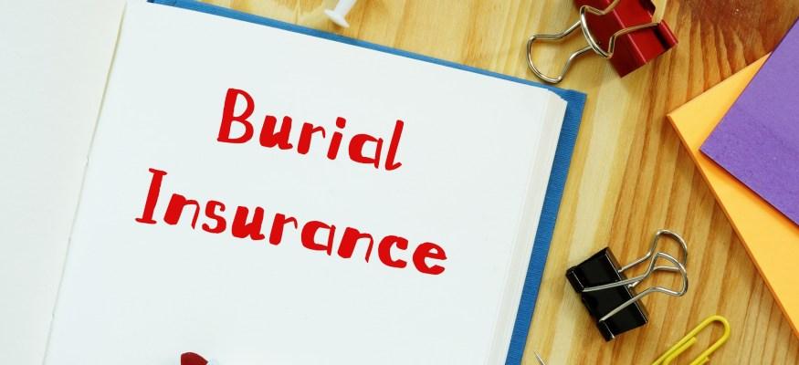 burial insurance written on a notepad