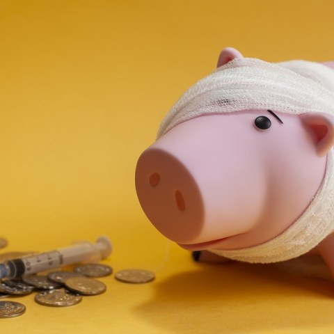 piggy bank with money in coins