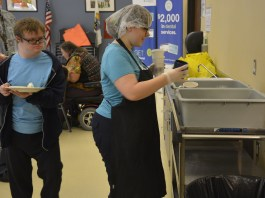 Students Jeff Shaver and Gloria Piele bus tables at Meals on Wheels at Washougal Senior Center