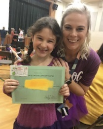 Shelby Artman Hough Elementary-Gives-A-Student-An-Award