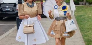 Downtown Camas Caroline Mercury and Virginia Warren in paper dresses
