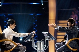 """Dev Patel, left, and Anil Kapoor in """"Slumdog Millionaire,"""" Forrest's pick to win Oscar's best picture race."""