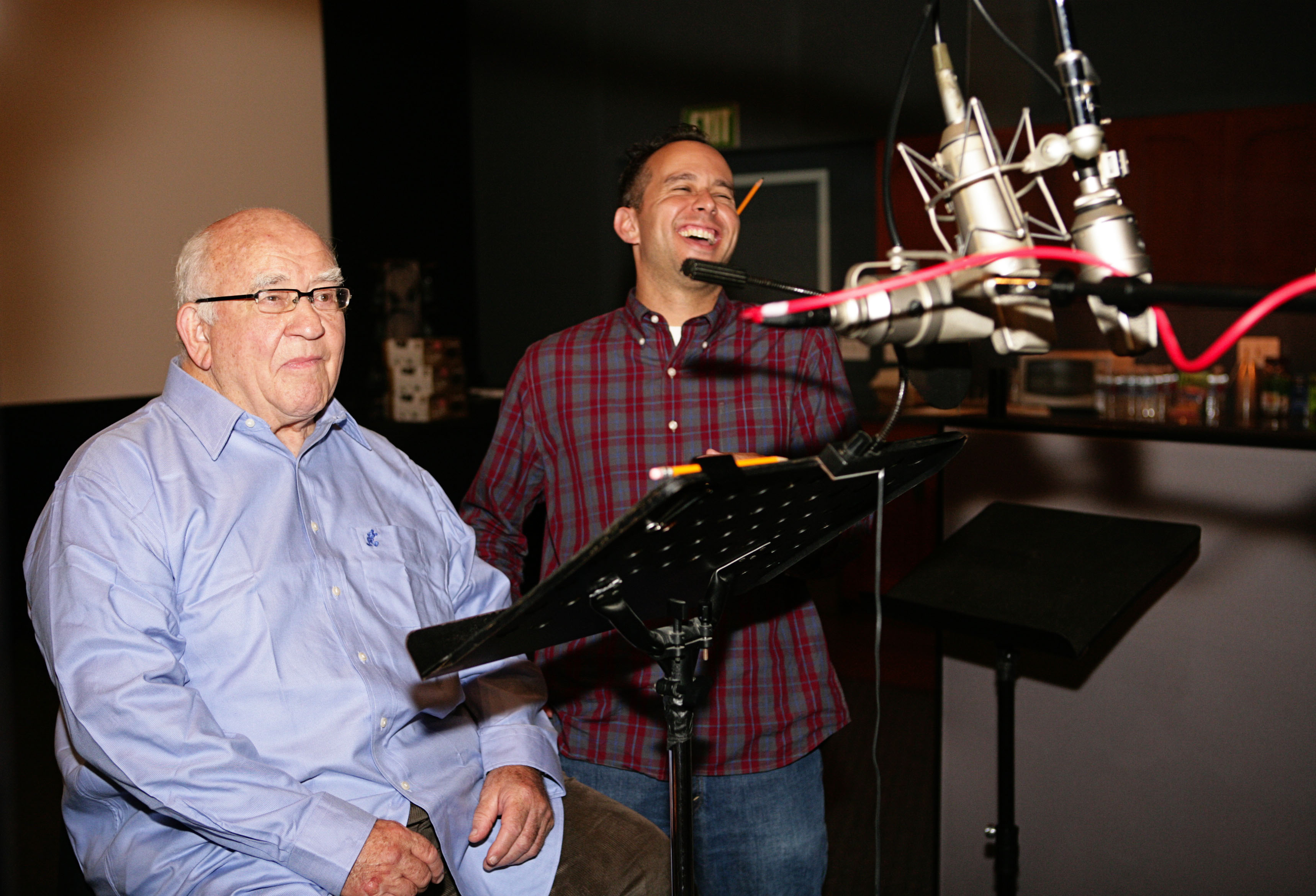 """Actor Ed Asner, left, and producer Jonas Rivera work on the vocal track for """"Up."""""""