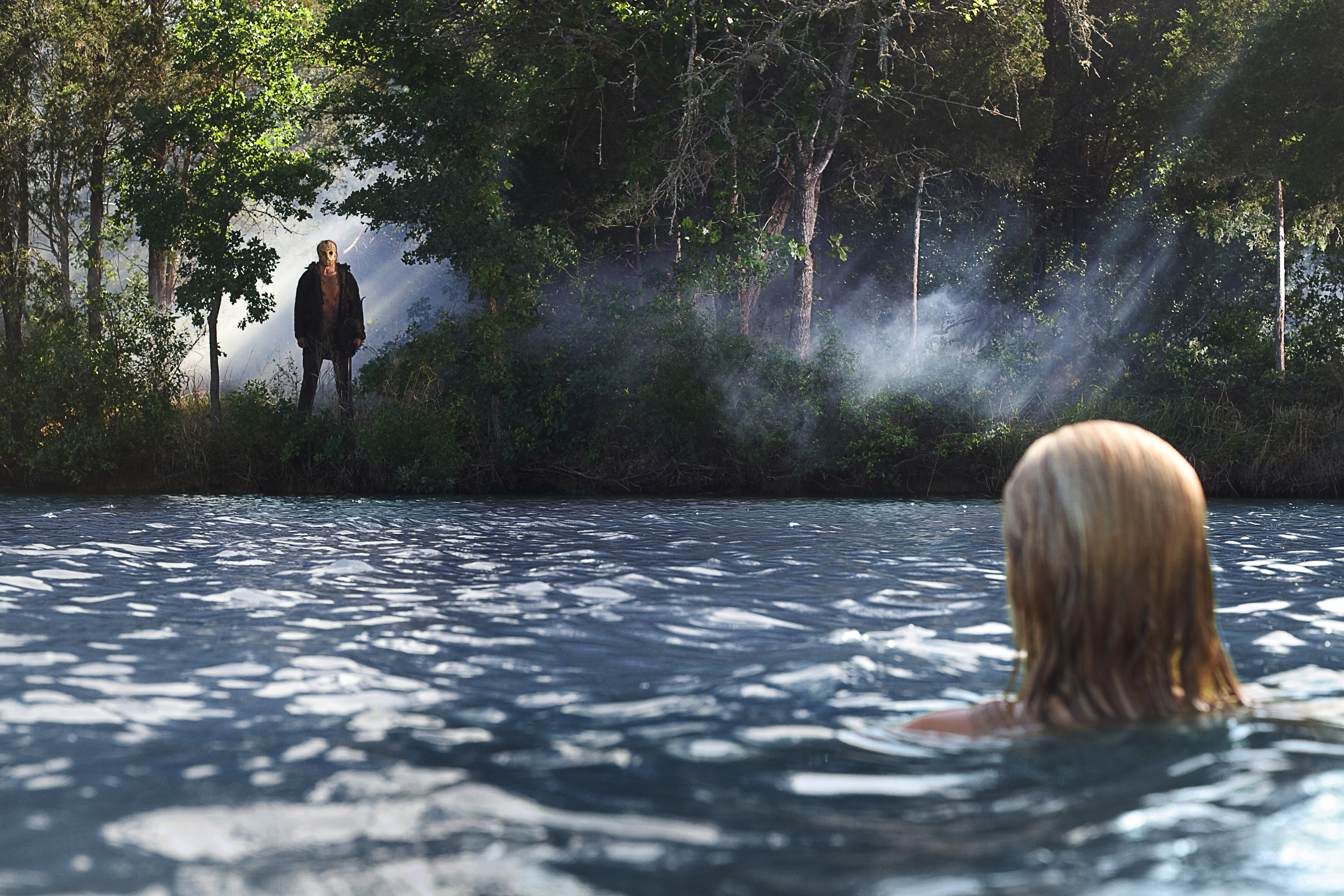 """Chelsea (Willa Ford) discovers Jason (Derek Mears) watching her from the shores of Crystal Lake in the 2009 remake of """"Friday the 13th."""""""