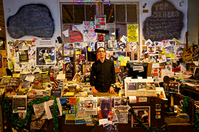 Owner Roger Stolle behind the counter at the Cat Head Blues Store.