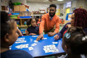 Reading Roadmap coordinator Taurean Morton helps students at Booker T. Washington school in Clarksdale, Miss. practice forming consonant-vowel-consonant words. Photos by Rory Doyle