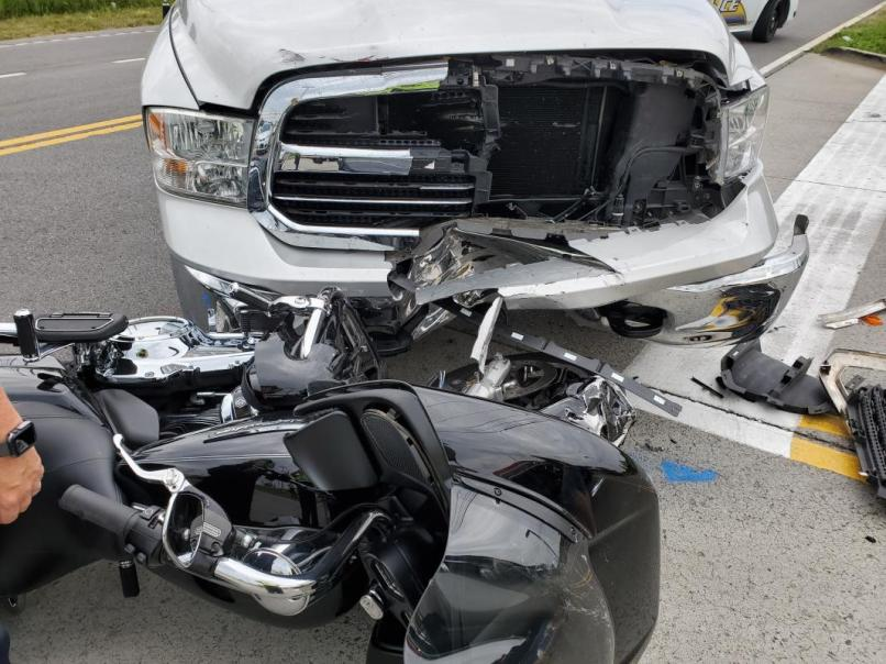 Motorcycle Collides With Truck On