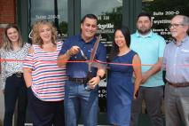 Cutting the ribbon of the Romano Alliance at the Chamber of Commerce