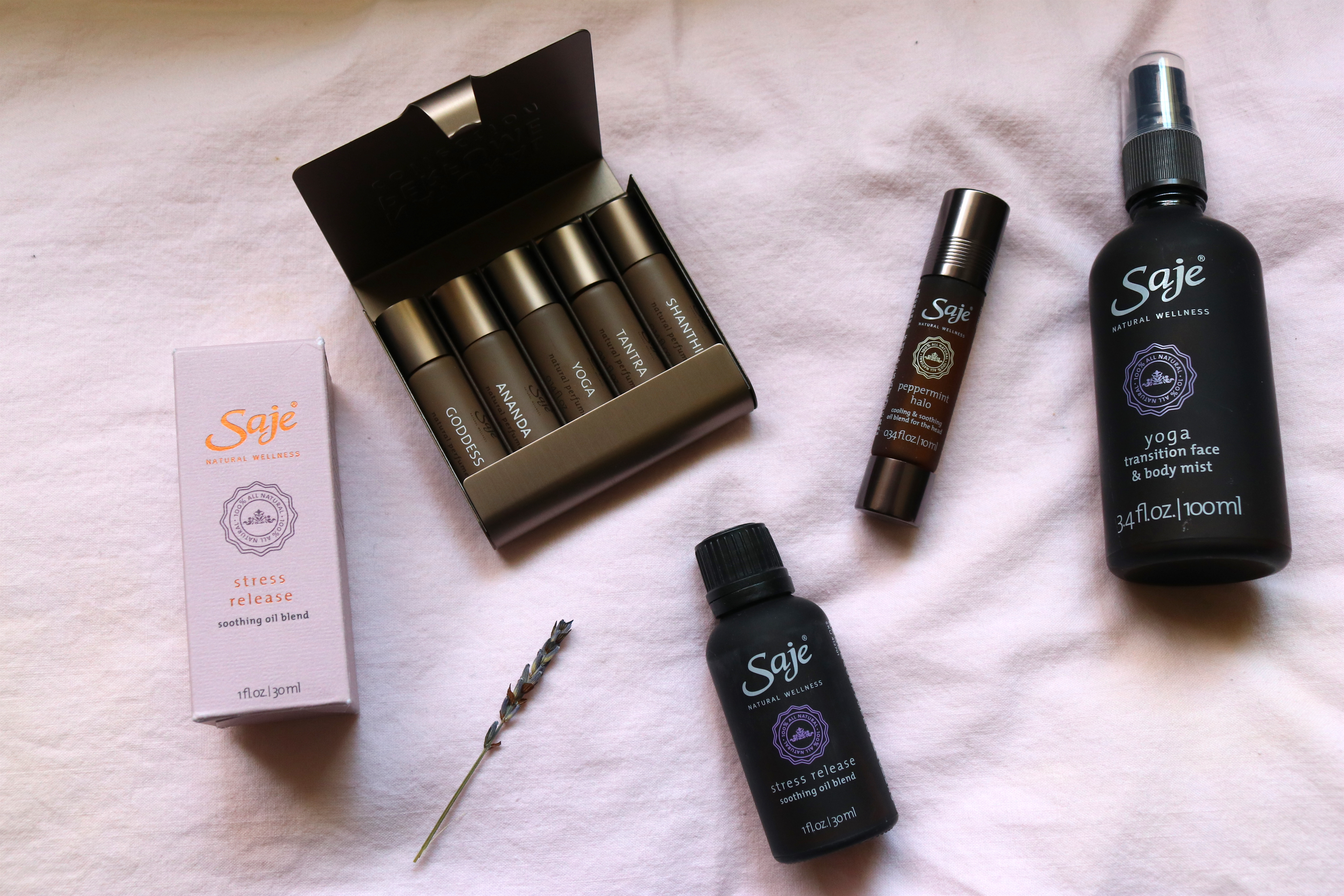 Saje Wellness Natural Perfume Collection Matches Your Mood With Gemstone Infused Rollerballs