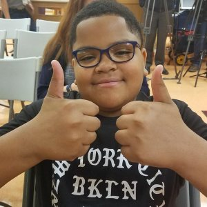 baltimore-boy-with-new-glasses-gives-two-thumbs-up