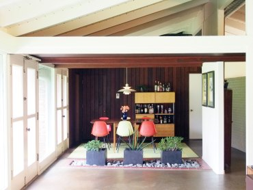 Mid-century Modern Dining area and planter with Poul Henningsen PH5 light