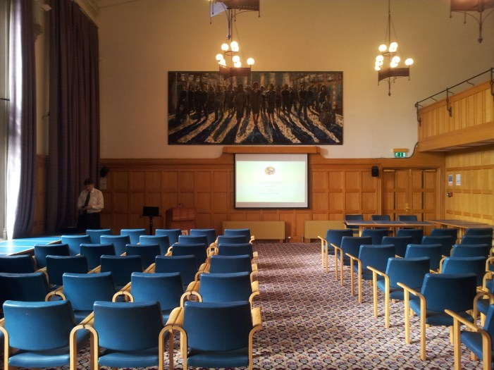Dr John Curran Prepares for the Opening in the QUB Council Chamber