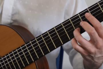 closeup of left hand holding guitar chord for Classical Guitar Lesson Tarrega Recuerdos de la Alhambra