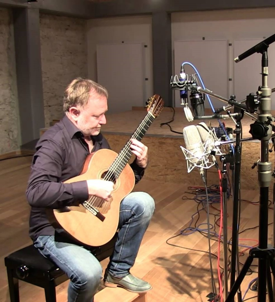 Guitarist/engineer Jan Zacek conducts a microphone test with models from Neumann, Schoeps, and B&K at Acustica Studio in Germany.
