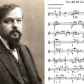 Composer Debussy alongside sheet music for Clair de Lune on classical guitar