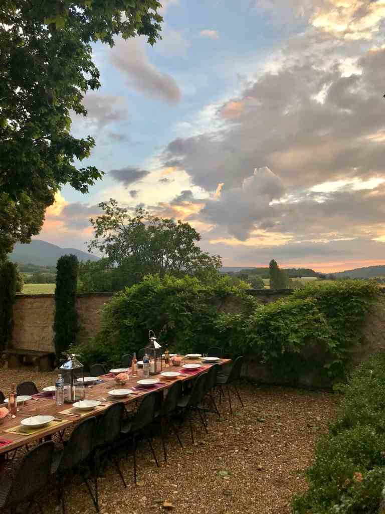 table set for dinner in Provence with sun setting