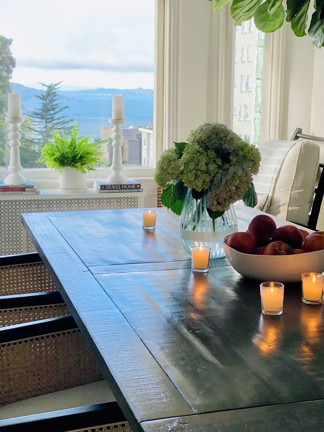 votive candles from dining room with view of San Francisco