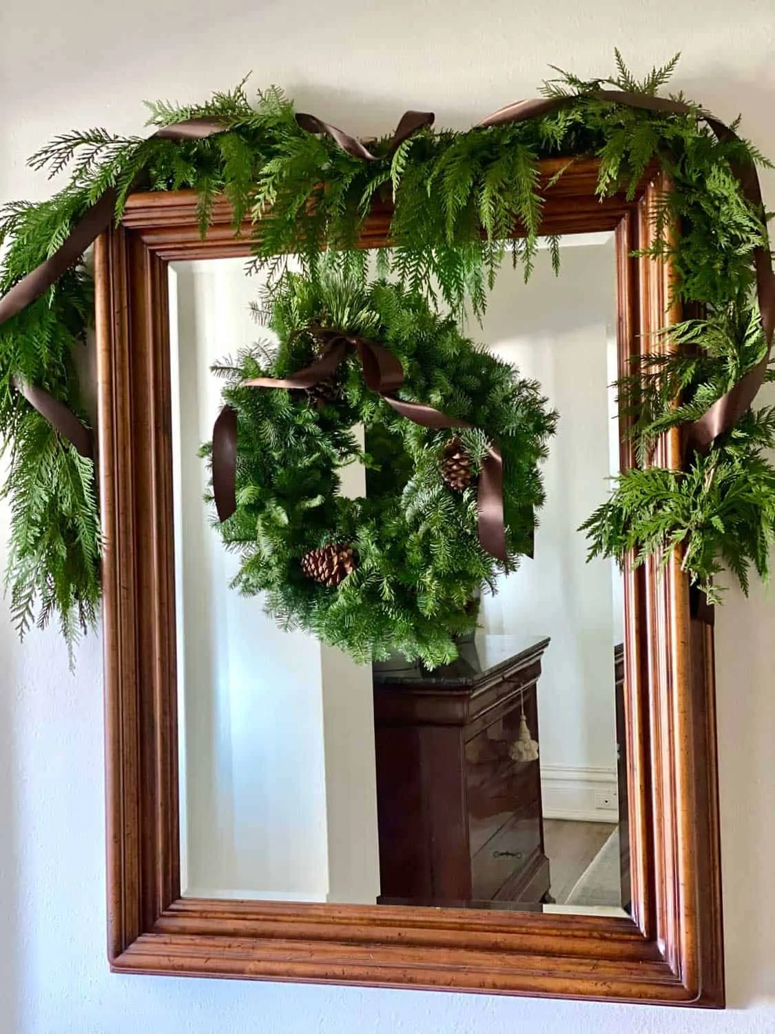 Mirror in Foyer decorated with pine swag and wreath