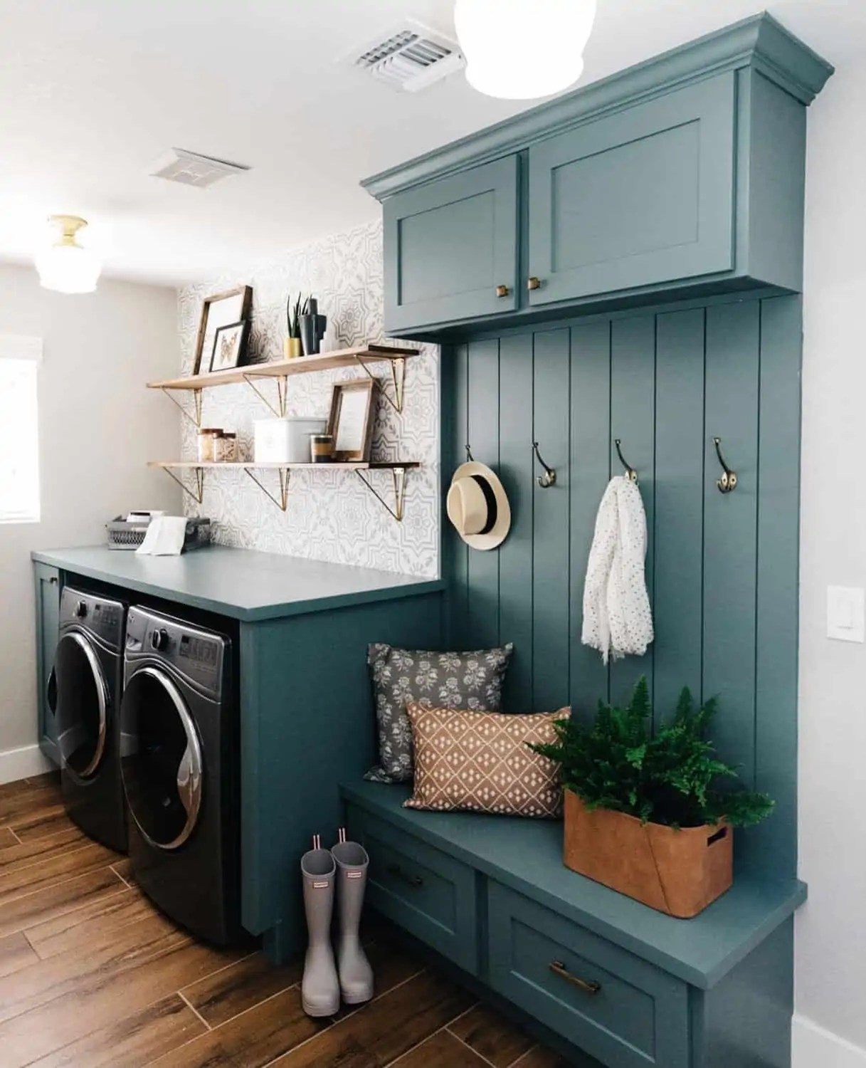 Teal laundry room with clothing hooks