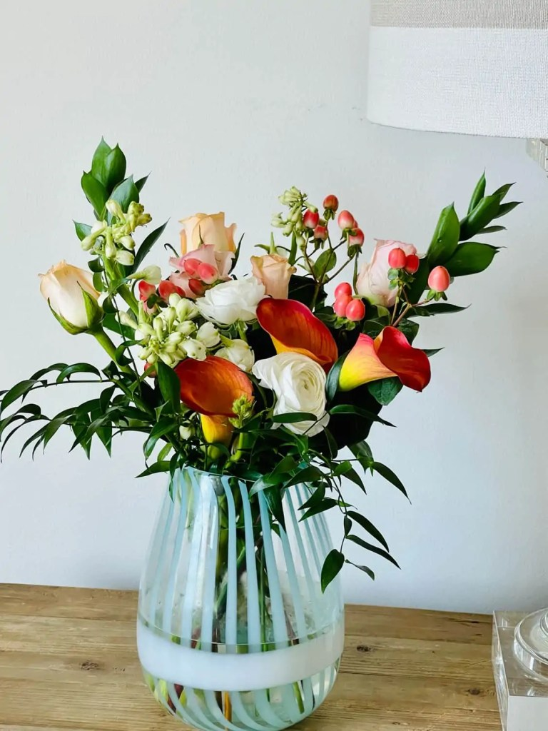 Colorful lilies and peach roses from Farm Girl Flowers