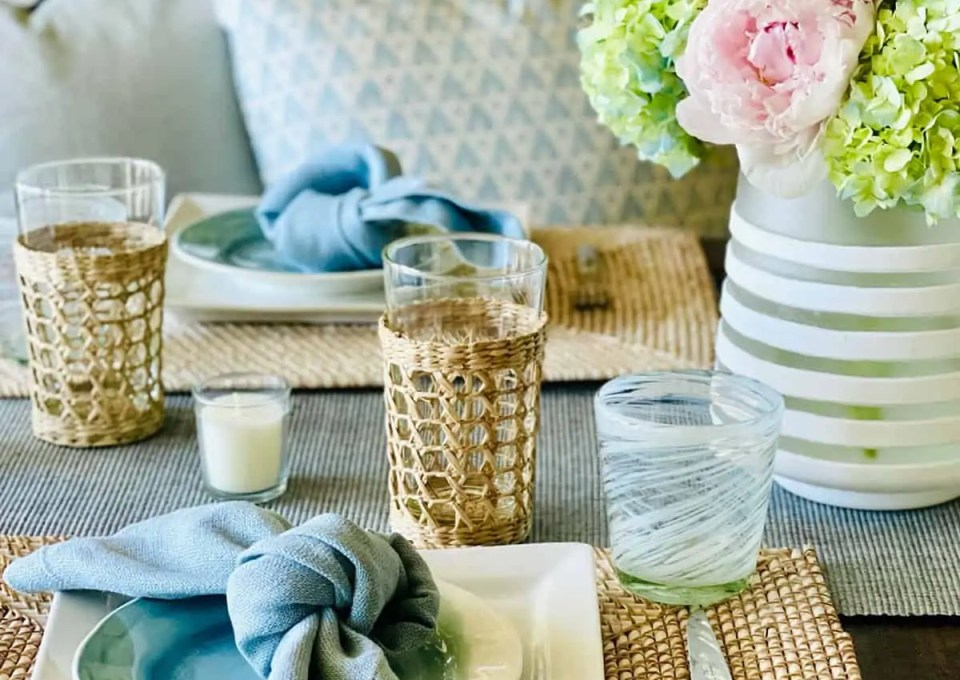 light blue and rattan table setting