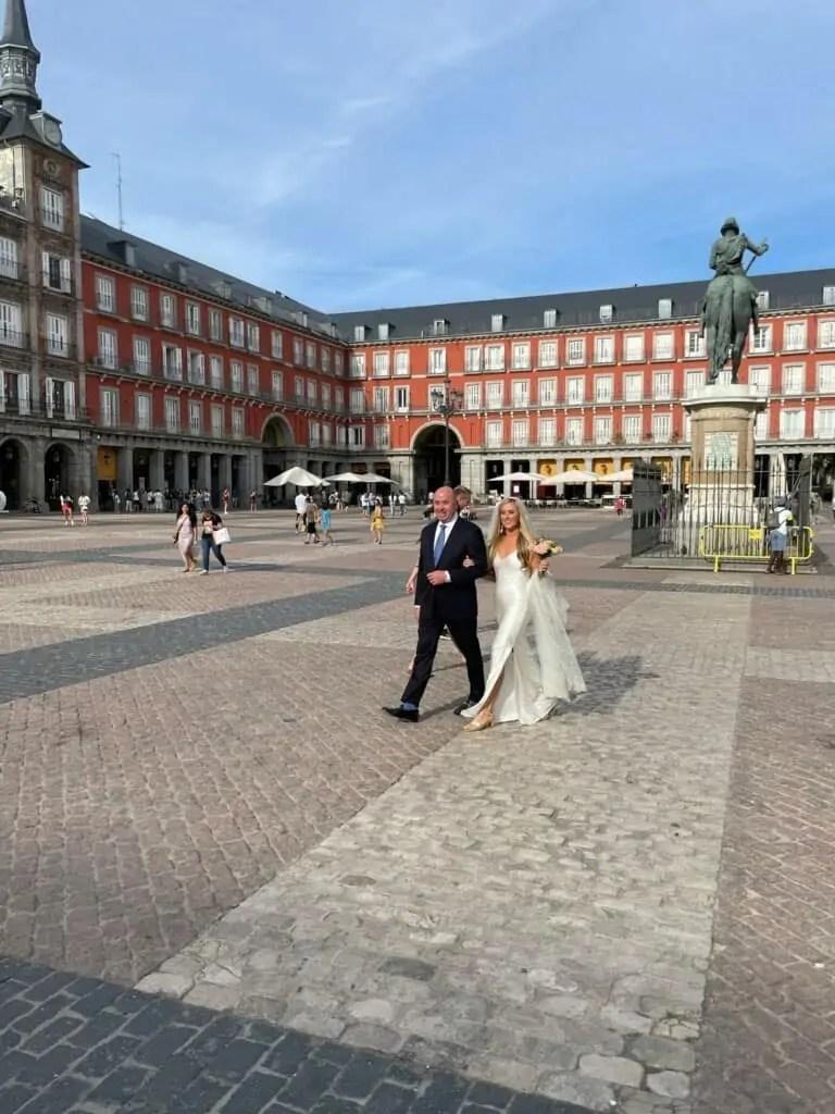 walking to simple wedding in Madrid