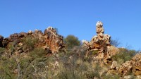 Rock outcrop, with two large rocks precariously balanced on top of another.