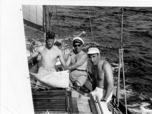 A previous owner at the helm with guests