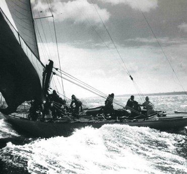 Hugh Goodson at the helm of Flica II in 1939