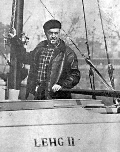 Vito Dumas at the helm