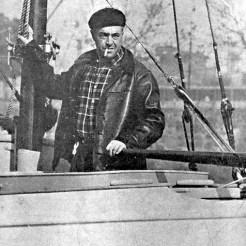 Vito Dumas at the helm
