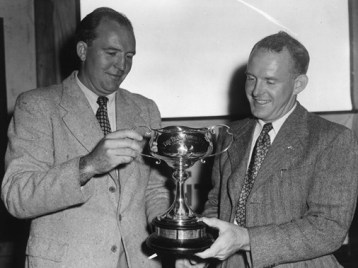 Magnus and Trygve Halvorsen with one of their winning Sydney-Hobart trophies.