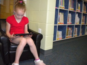 girl reading ipad