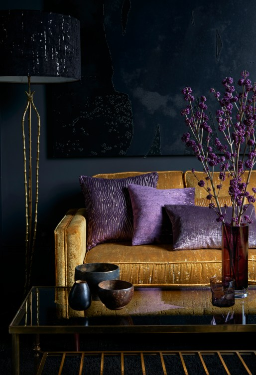 "alt=""Mustard Sofa with purple cushions made using fabric from the Clarke & Clarke Dimensions collection"""