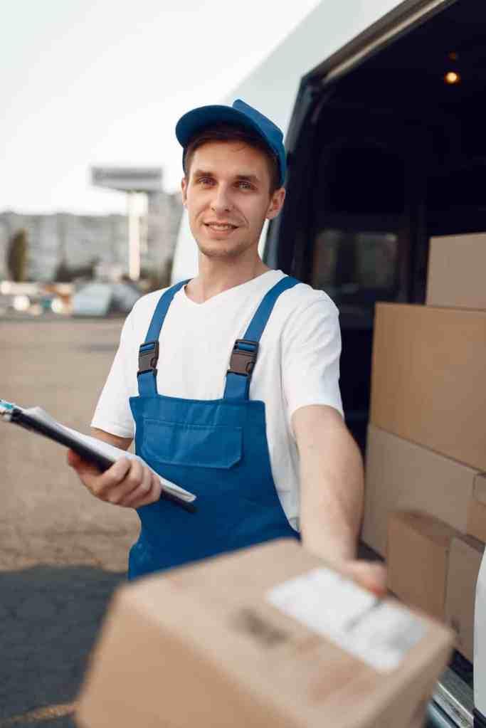 Deliveryman in uniform gives parcel, delivery