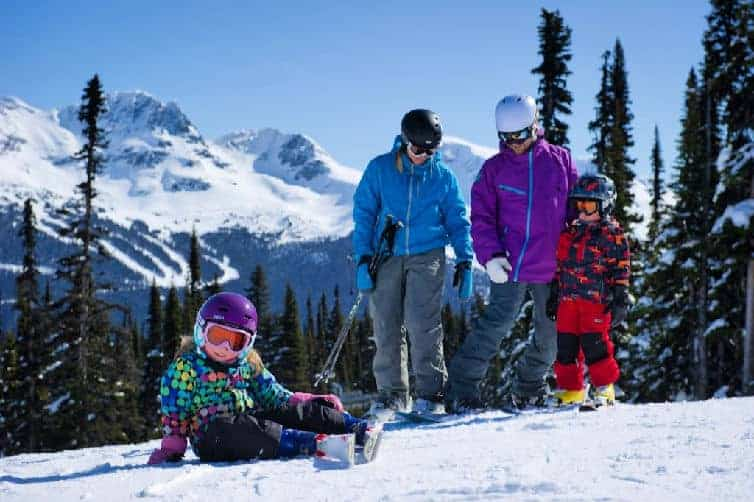 family with kids skiing at whistler