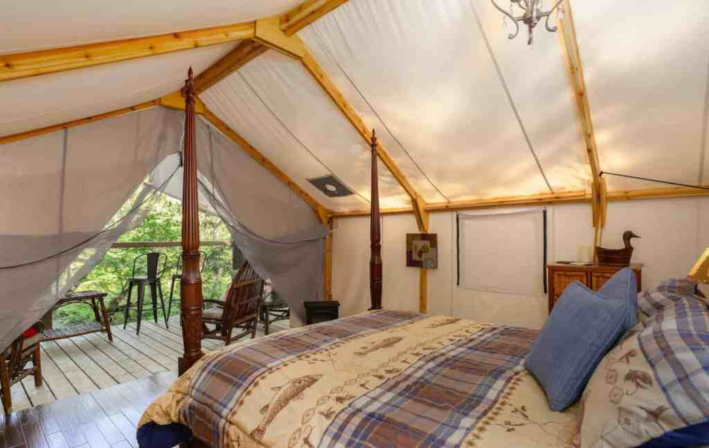 bed inside glamping tent mission airbnb