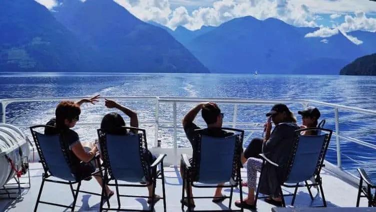 people enjoying sunshine on dock of boat