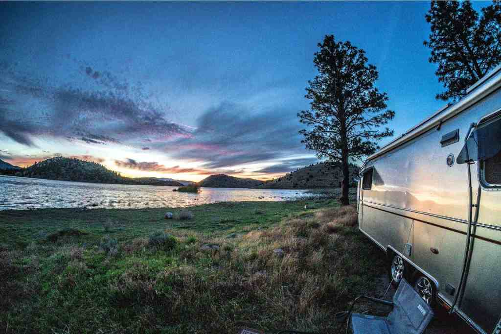 airstream overlooking lake camping in bc