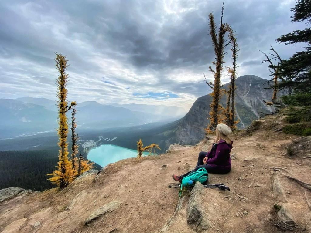 lady sitting on beehive hike in lake louise
