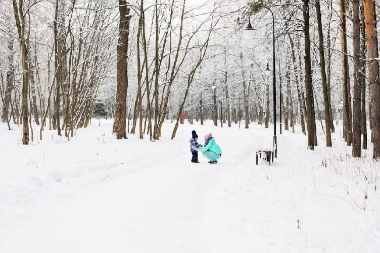 mom and child in snowy forest