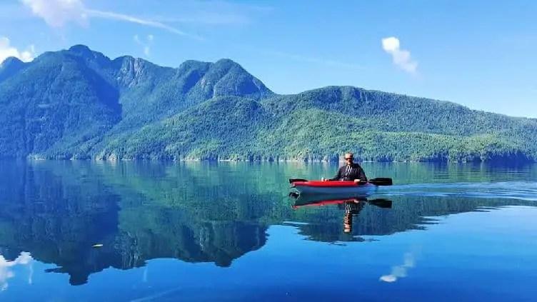 man in kayak in desolation sound