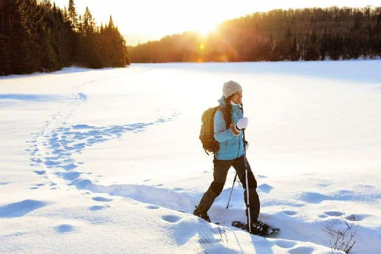 lady snowshoeing in quebec in winter