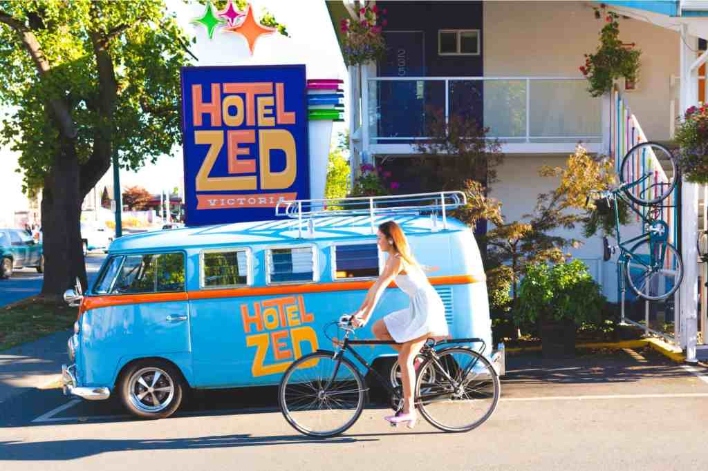 girl on bicycle in front of hotel zed