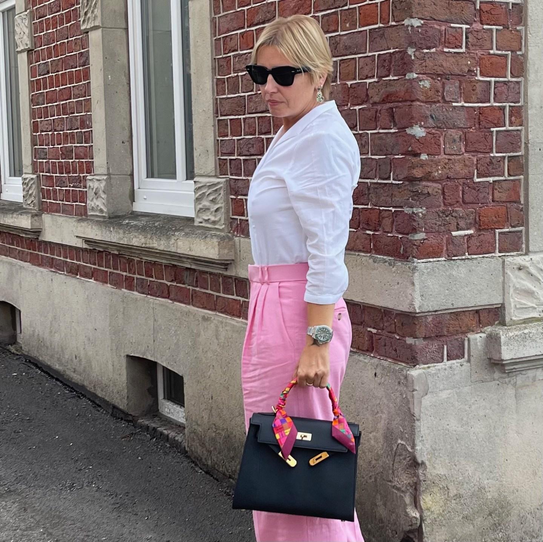 pink wideleg pants and Hermès Kelly bag