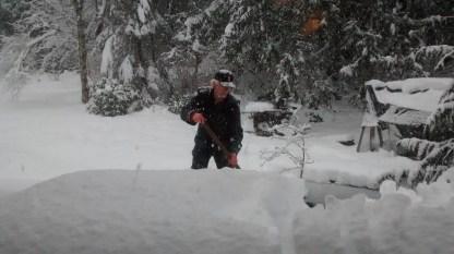 C. shoveling snow....