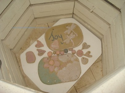 These are the dry pieces loaded for a bisque firing.