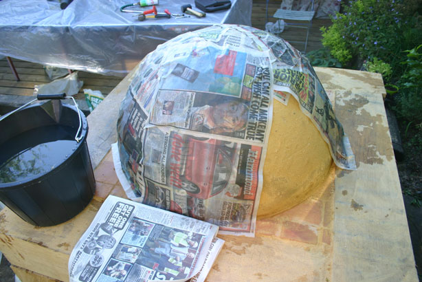 Sand dome partly covered with wet newspaper.
