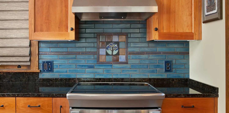 arts crafts tile mural behind stove